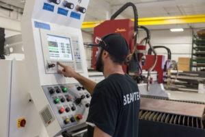 PA plasma cutting technician at work